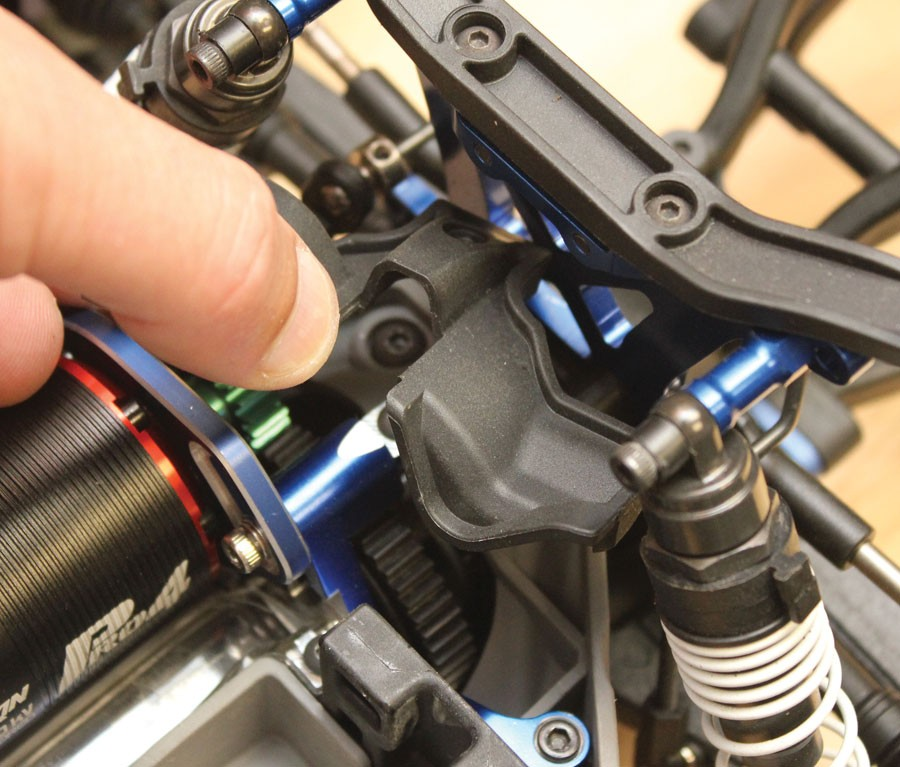 A single screw secures the gear cover. Remove it and the cover so you can loosen the motor in its mount.
