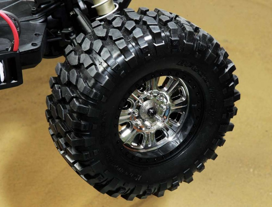 Look at those burley off-road lugs on the BFGoodrich Krawler TA tires, they will mutilate any terrain. The licensed Raceline wheels look cool with their two-tone finish and are secured with a steel Axial washer and 8mm nut.