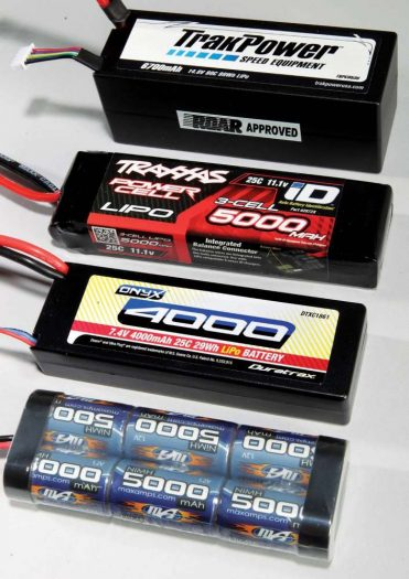 Here are some examples of battery types. From the bot- tom to the top: a 7.2V NiMh pack, a 2S 7.4V LiPo Pack, a 3S 11.1V LiPo Pack and a 4S 14.8V LiPo Pack. The higher the volt- age, the faster the vehicle.