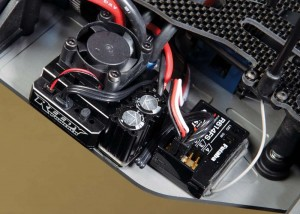 Reedy's Blackbox 401R Competition ESC has final- ly reared its head and sits comfortably next to the Futaba receiver.