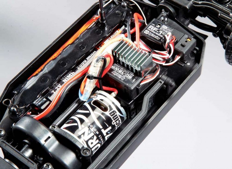 With the motor placed up front, the steering servo is located behind the motor so a long steering link spans from the servo around the motor to the front bell-crank steering.