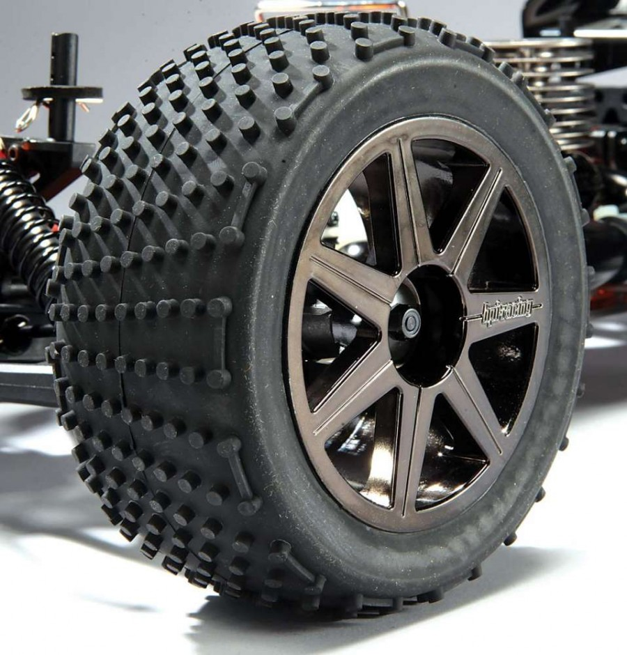 Multi-Pin truggy tires molded in a medium com- pound rubber will grab and tear up grass, dirt and sand. The black spoke rims give the truck an aggressive look.