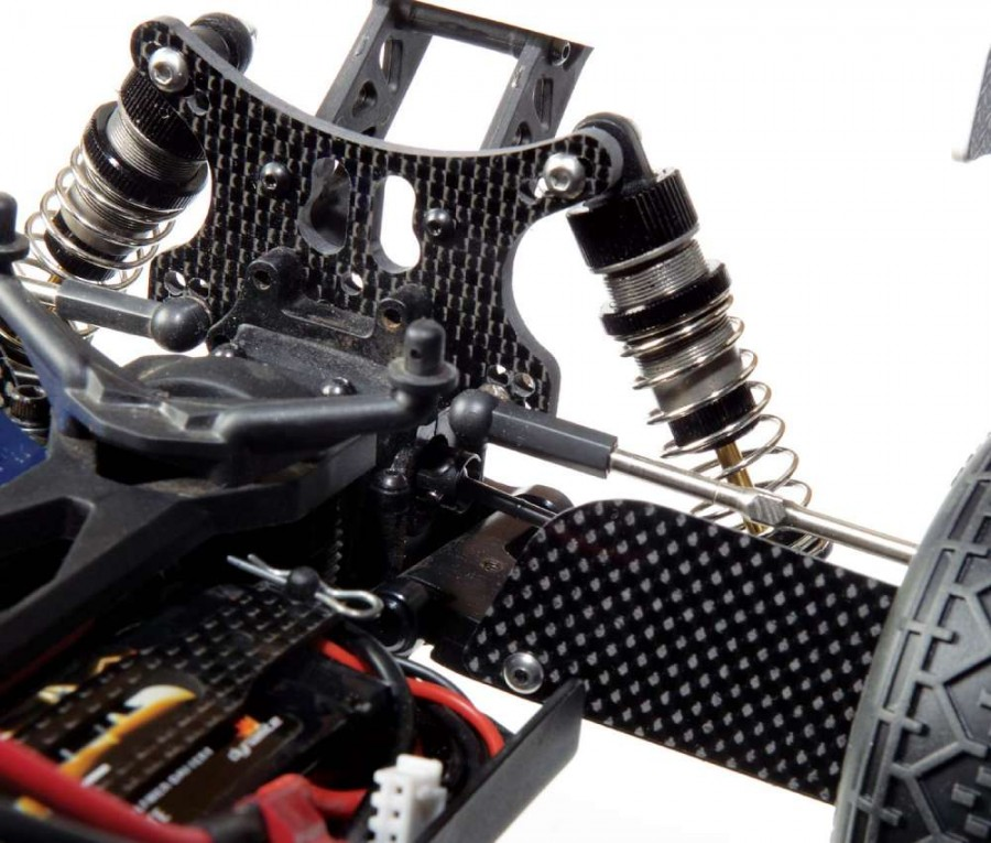 Xtreme Racing provided me with all the graphite compo- nents I needed including the rear shock tower, rear mud guards, battery strap and the front shock tower (not pic- tured). All the shocks now feature hard anodized bodies and TiNi coated shafts so they are as smooth as butter.