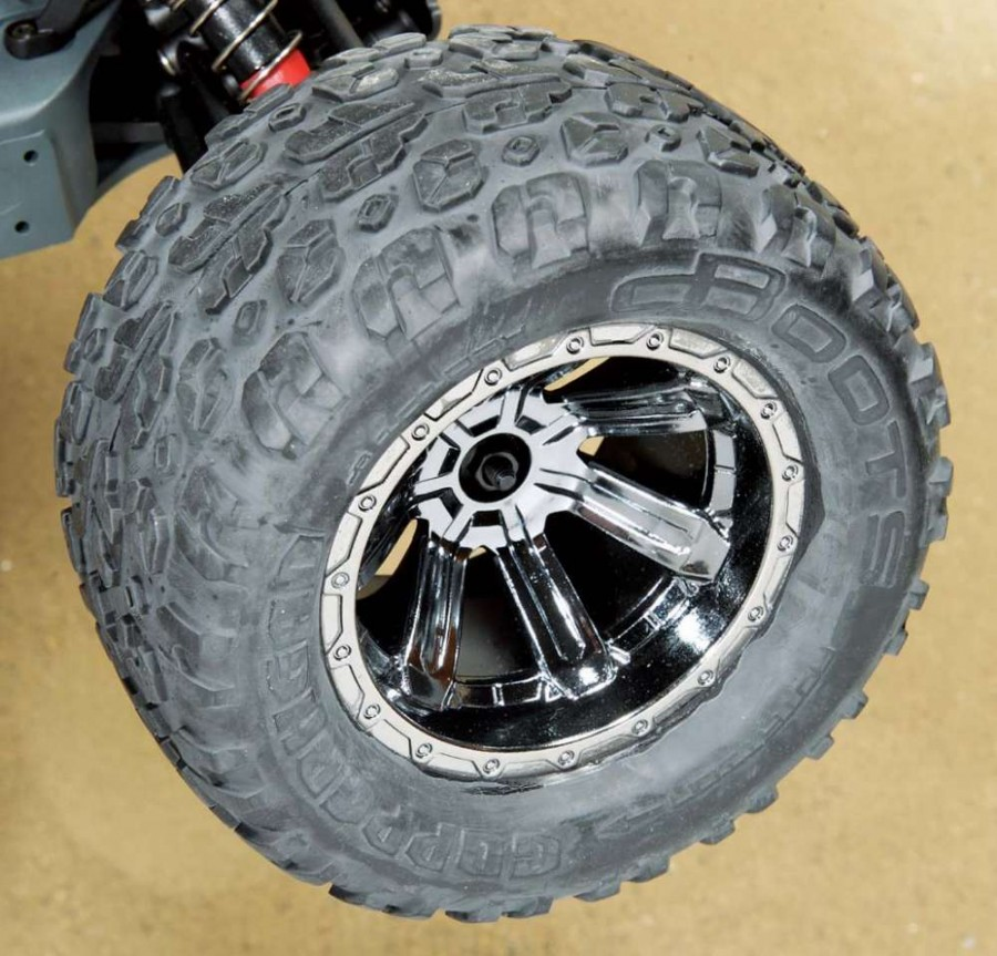 Very nice-looking 7-spoke black chrome nylon wheels are wrapped with multi surface dBoots tires.