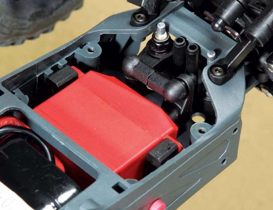 Under a plastic hatch in the chassis rests the Arrma ADS-5 waterproof steering servo which is welcome on an off-road vehicle where hitting some H2O is likely.