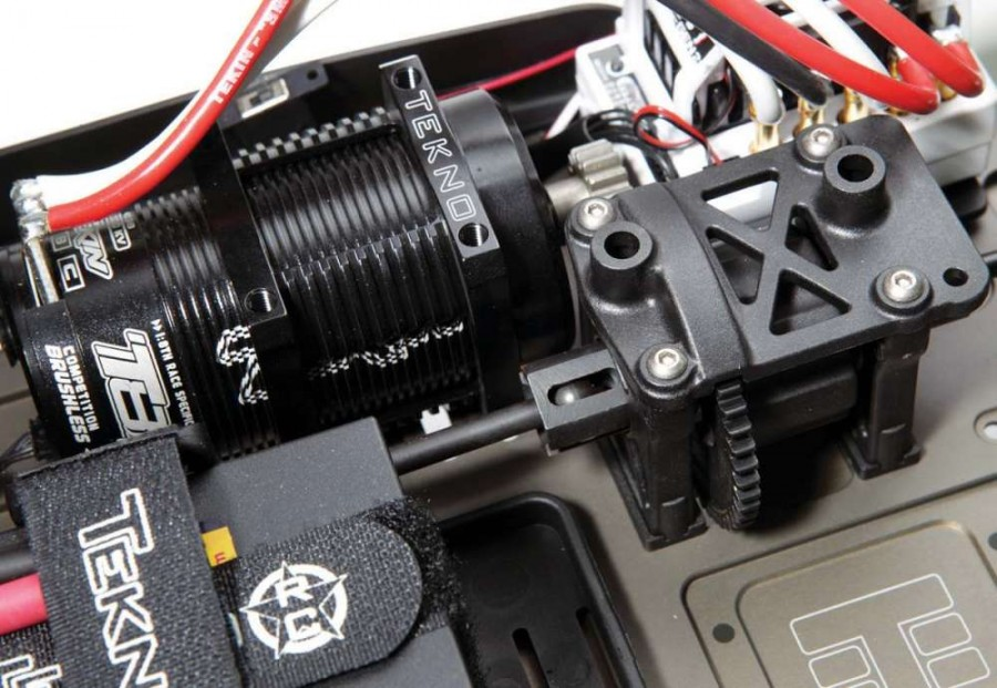 The Tekno conversion includes a 42mm motor mount that accepts our Tekin T8 motor. The motor sits in the center and the conversion relocates the differential to the rear of the chassis.