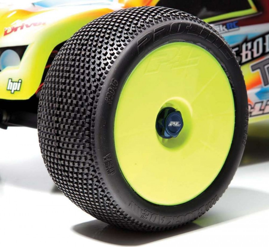Pro-Line M3 Blockade tires mounted on ProLine VTR yellow wheels retained with Pro- Line Pro-Cap 17mm wheel nuts. Are you see- ing a pattern here? You're right that is a Pro- Line Bull-dog body in the background! The truggy is set up with pure racing parts.