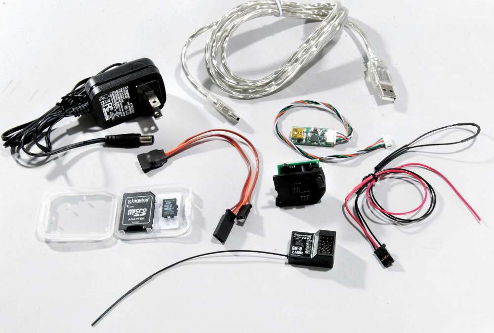 Lots of stuff is included in the package. You get the GR-8 telemetry receiver, charger, USB cable, USB adapter for the receiver, microSD card and adapter, switch plate for left hand conversion, and a telemetry harness for temperature and battery voltage.