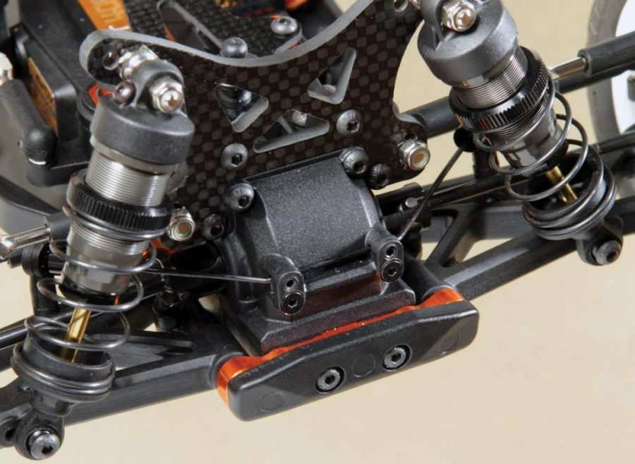 Carbon shock towers, threaded aluminum shocks, orange aluminum hinge pin braces and the anti-roll bar are all standard features on the TM4. That's alot of high-end parts right there!