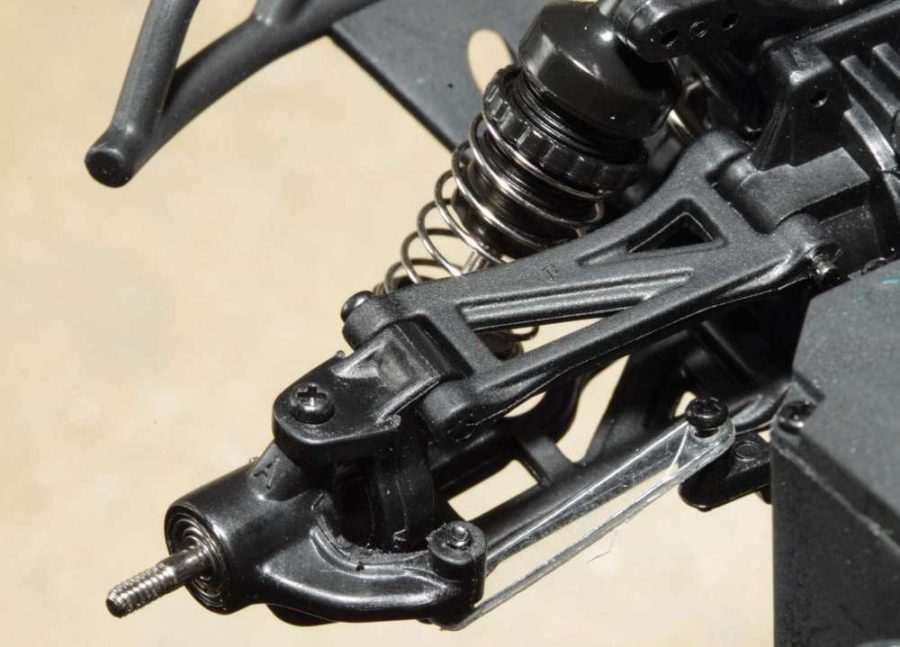 Upper and lower control suspension arms and thin flexibly steering turnbuck- les are used on all four corns of the Micro SCT and Micro Rally-X. While super small, the shocks are oil dampened and the plastic bodies are threaded to make preload adjustments quick.