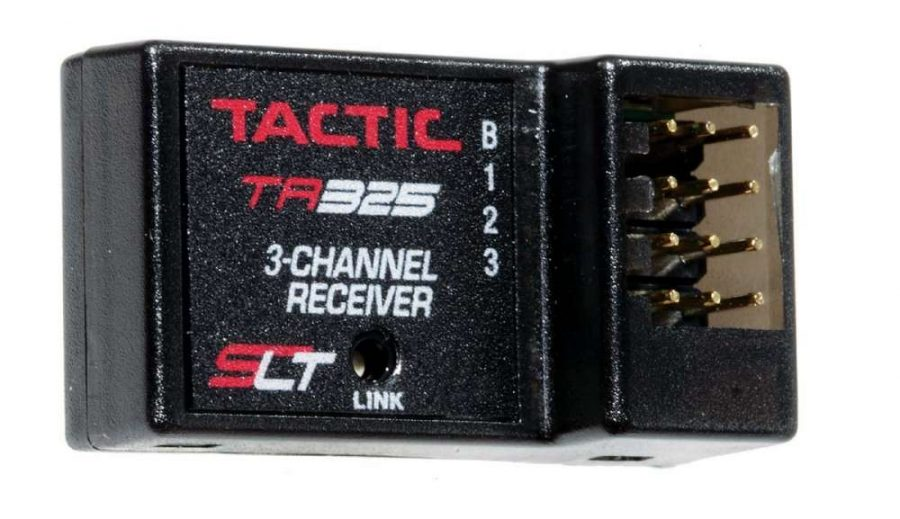 The compact receiver fea- tures three channels plus a battery terminal which I used to power my Power Wagons lights.