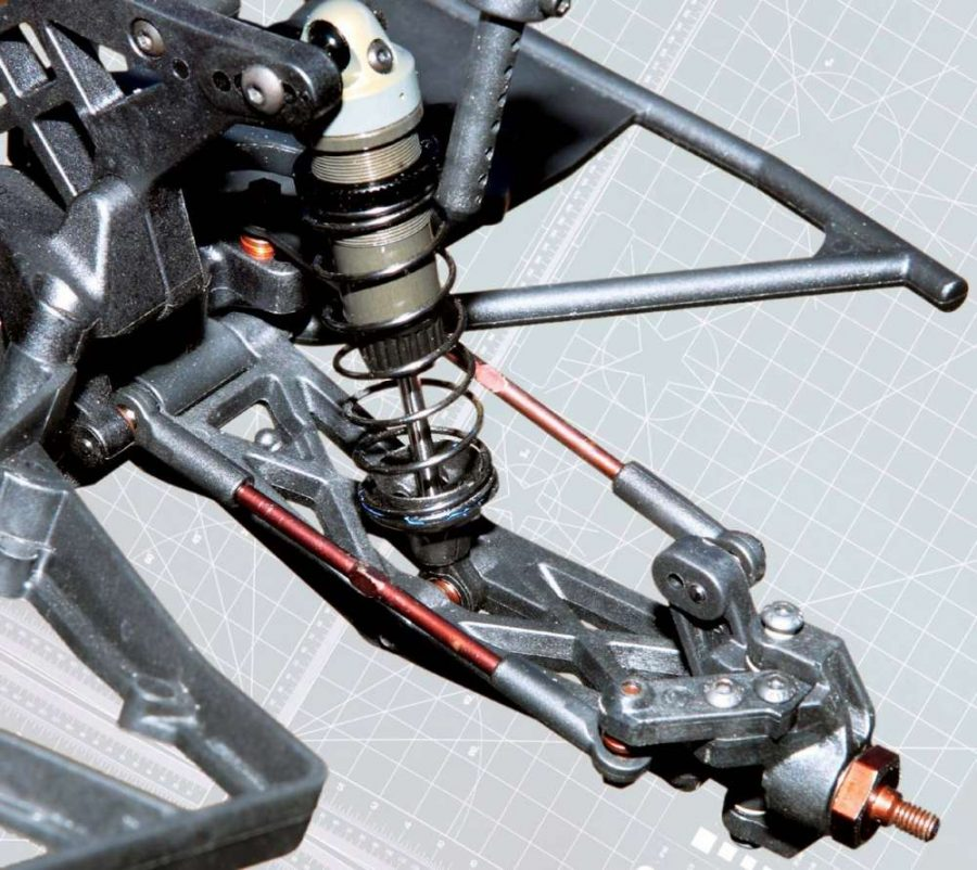 Lots of strong, lightweight, spring steel is used on this SC truck for the tie-rods, ball ends and the front wheel hex axle stub. Check out the steering knuckle with the interchangeable arm. Serpent even offers brass arms to add weight over the wheel.