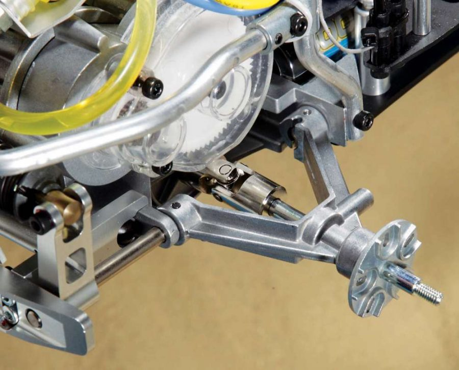 The rear end uses a unique V-shaped suspension arm that rotates on two pivot points. You might also notice the new shock mounts and rear bumper; both now come as machined parts.