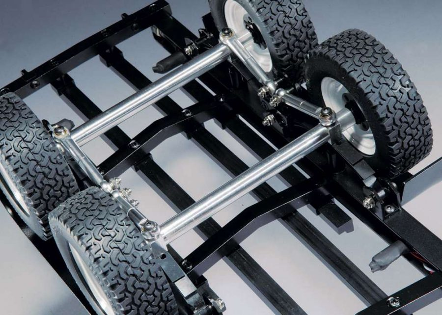 The trailer features dual axles to carry heavier boats. The axle tubes are made out of aluminum and are supported by ball bearings. The wheels are bolted to 12mm hexes so you can swap out the wheels to match your truck if necessary. Metal links keep the axles in place.