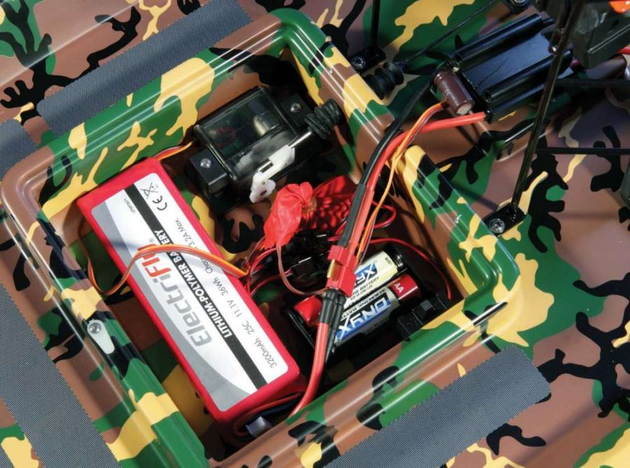 The receiver, steering servo, drive battery and spotlight batteries are all located in an easy access hatch.