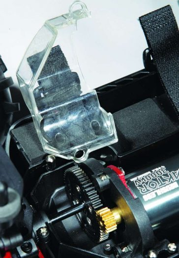 Included is a clear plastic gear mesh guard for driving condi- tions that are muddy or wet.