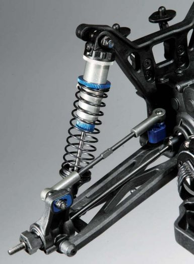 Factory 12mm, V2 Big Bore shocks help give the suspension a nice, cushy ride. CVA axles are also standard as are the blue camber link inserts.