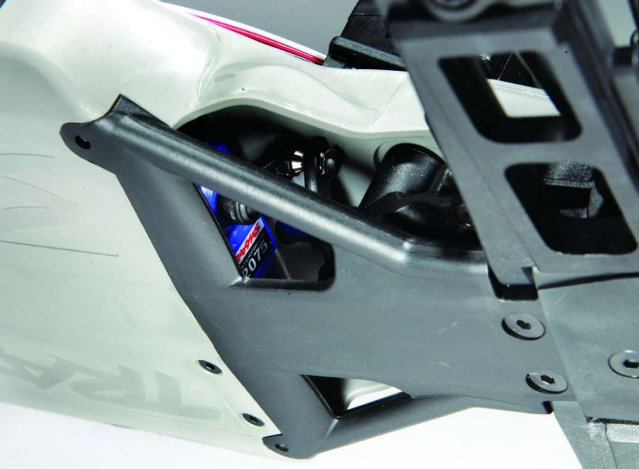 A separate lower skid plate protects the servo and steering system. Cutouts allow debris to easily exit and not jam up the steering.