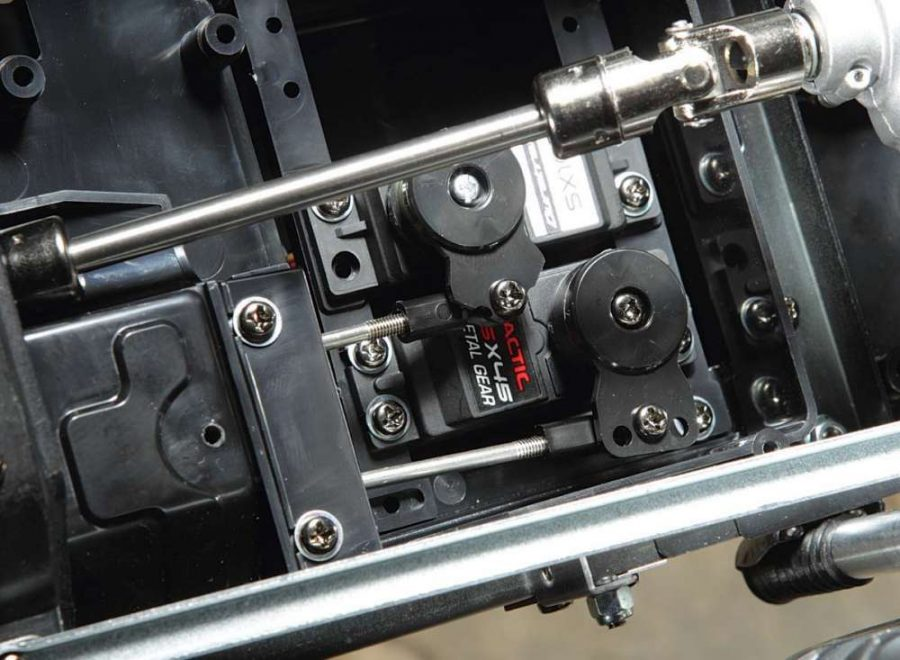 The servos are located in the truck's large radio box and actually sit face down. The Tactic servo is the steering servo and the RC Gear/ Duratrax servo is the shift servo; both are fitted with servo savers. The rods exit the box through a rubber flap to help keep debris out of the electronics area.