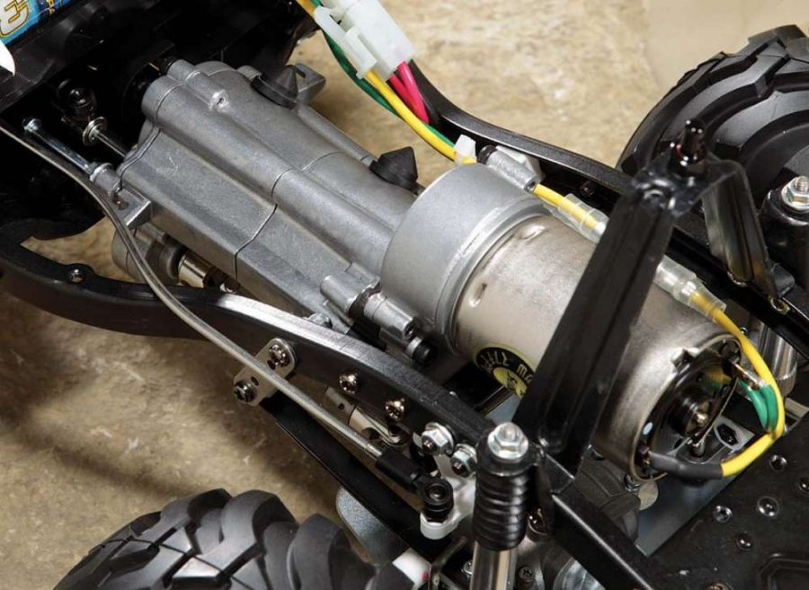 Check out that transmission case, it's cast metal and loaded with the metal gears that make up the switchable transmission. The case has the trans- fer case built in to send power to the front and rear sliding driveshafts.