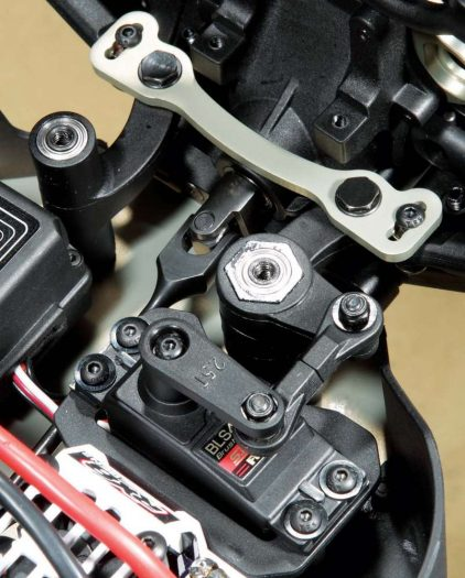 Ball bearings support the steering cranks and the drag link. The composite steering cranks have some heft to them and the servo saver has an adjustable thumb nut to adjust tension.