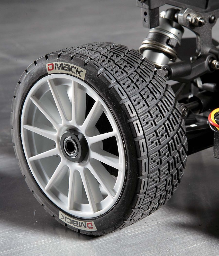 To lay down the traction on both dirt and asphalt, Basher wrapped the 1/8 size rims in a rally type block tread. The hexes on the car are 17mm so you can use aftermarket 1/8 wheels.