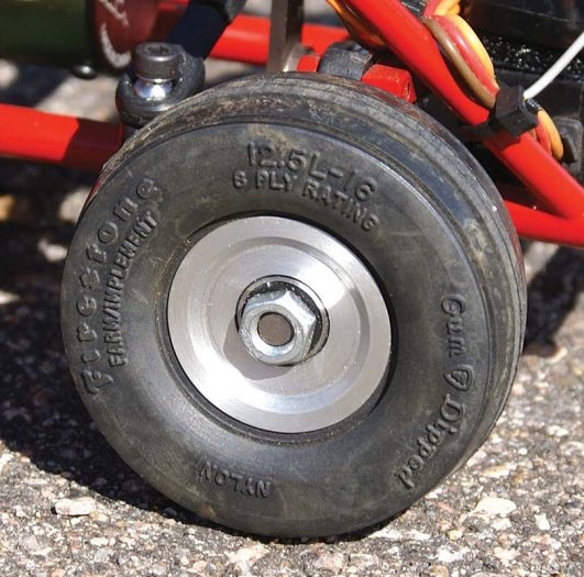 Firestone tires designed for 1/16 scale tractors were used for the front. They are mounted on custom aluminum rims.