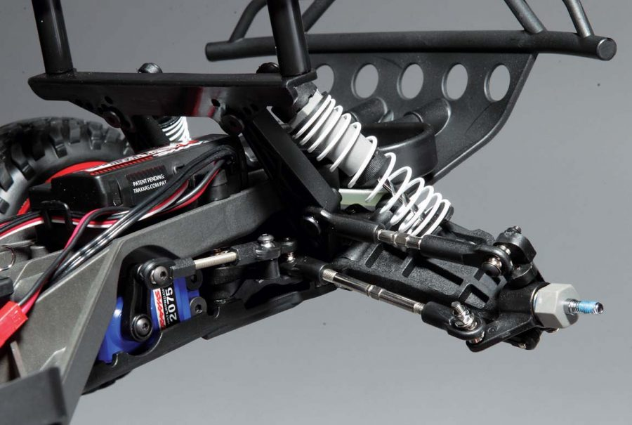 With the new LCG chassis the servo is now mounted flat and is turned to the side. The dual bellcrank steering linkage incorporates a spring loaded servo saver to protect the gears in the waterproof servo. The entire steering set-up is super tough, responsive and adjustable.