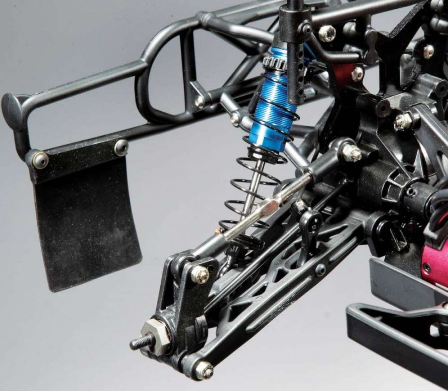 The rear suspension also comes from the TLR 2.0, using 4mm thick turnbuckles and beefy CVDs. Also pictured are the aluminum-bodied, threaded shocks.
